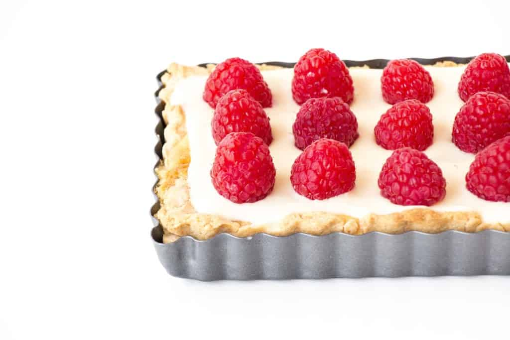 White Chocolate Raspberry Cheesecake - A beautiful cheesecake that is creamy on the inside and a little tangy on top.