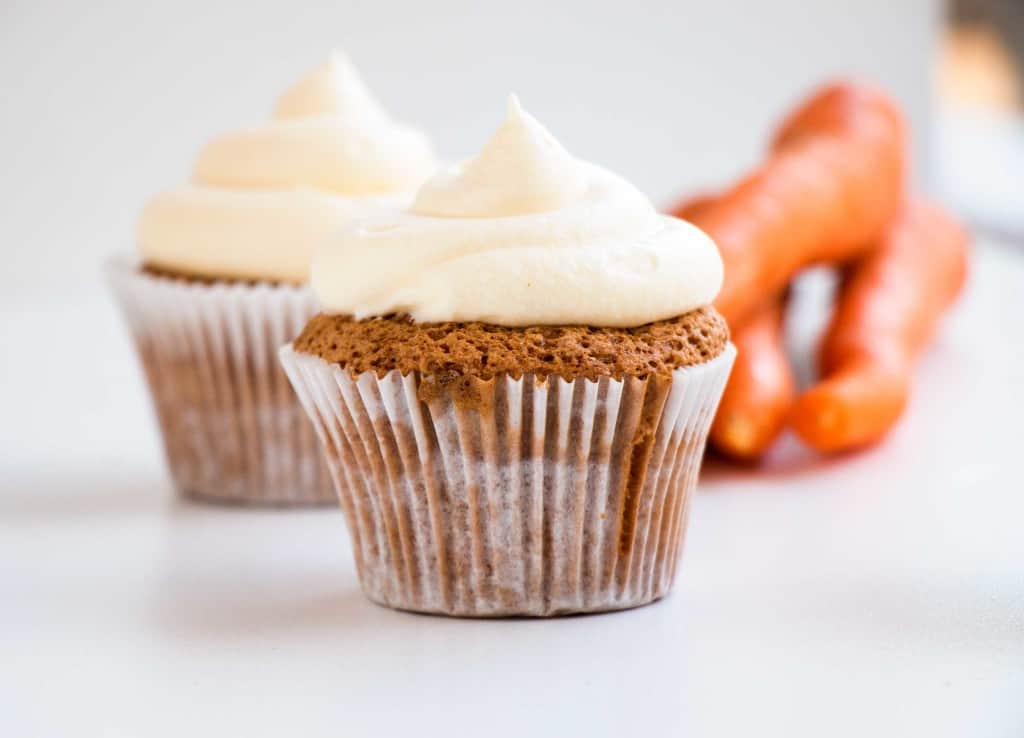 Moist Carrot Cake Cupcakes - Delicious, easy to make carrot cupcakes that are super moist and fluffy and topped with cream cheese frosting.