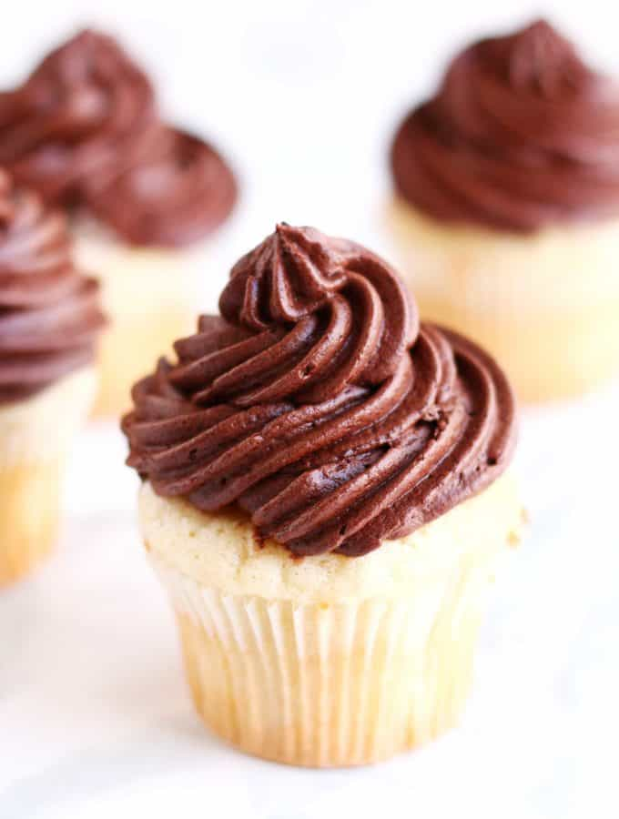 The ultimate go to cupcake recipe, this moist vanilla cupcake recipe with creamy chocolate frosting only takes a few minutes to whip up and can be frozen for up to a few weeks! The only cupcake recipe you will ever need!